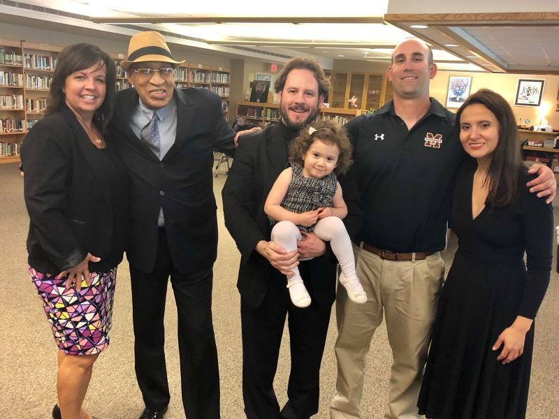 Spanish Opera Singer Israel Lozano, (center) with his wife and daughter visit the St. Joseph Resource Center at BMHS. Shown here with Mr. Lozano is, left, Development Director Sandy Mammano, and (right) BMHS Teacher and Coach Mr. Anthony Sosnoskie.