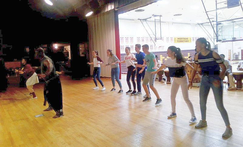 Spain Exchange students from Pampaloma, Spain enjoy Traditional African Dance class at Bishop McNamara High School in Forestville, Maryland