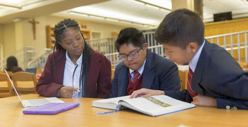 Raymond Tetschner, at center, studies with some of his fellow students at Bishop McNamara High School. (CS photo/Jaclyn Lippelmann)