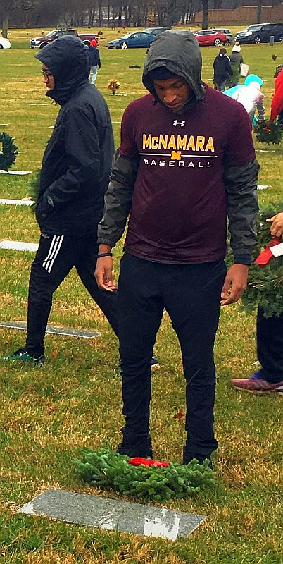 Bishop McNamara High School Baseball team joins the community placing wreaths on the graves of our country's fallen heroes, saying the name of each and every veteran aloud