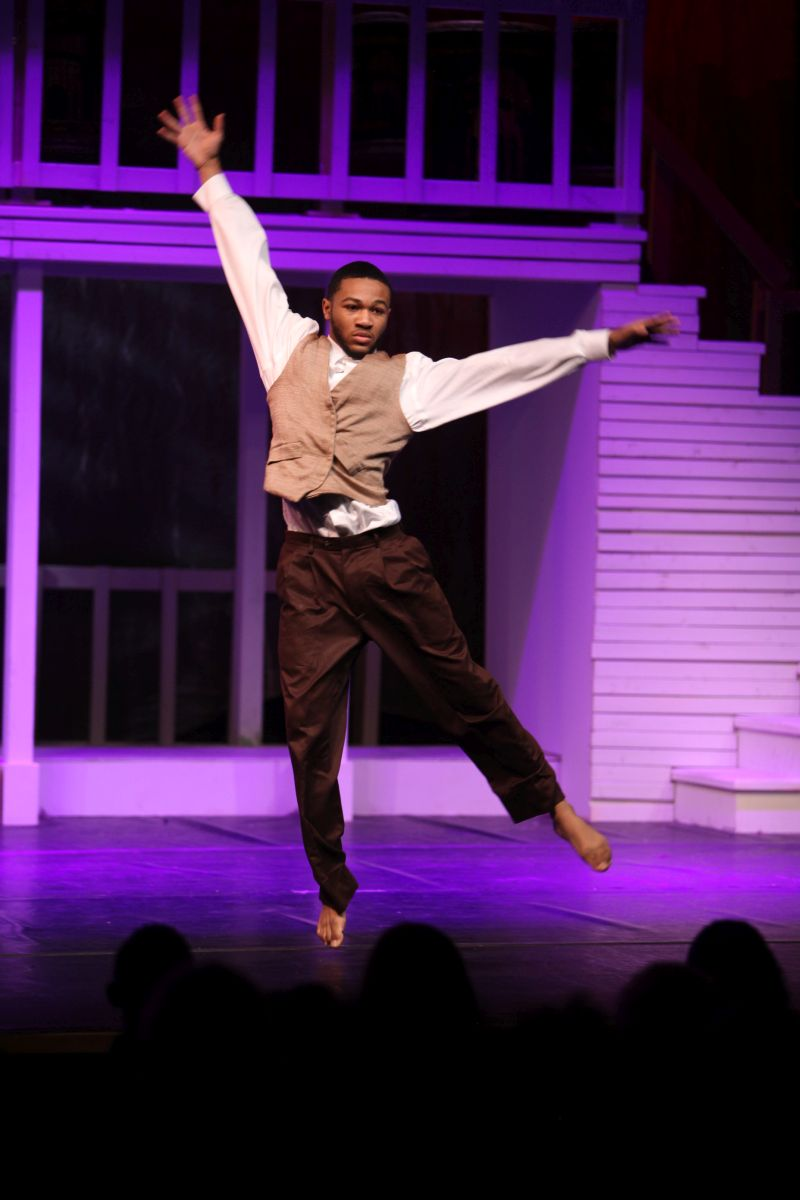 "Sankofa production ""Violet"", male dancer leaping"