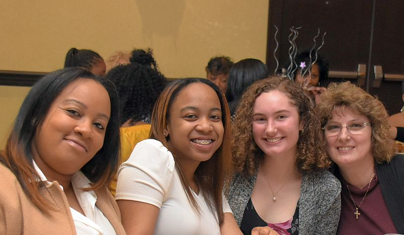 Students with their mothers at the Mother Daughter Brunch in 2018